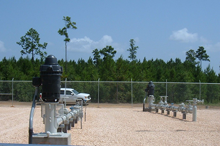 PW-1, Foreground, and PW-2 of This New 4.32 MGD Industrial Wellfield.  Woods Seen in the Background Are What the Property Looked Like at the Project's Inception